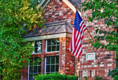 American flag in front of windows in red brick home   Best Glass Options for your Southern Atlanta Home Window Repair   Window Makeover