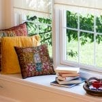 Coffee, Books and Pillows in Window Seat | Window Repair When Home Settles | Window Makeover Inc
